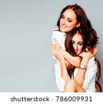 two sisters twins girl posing ... | Shutterstock . vector #786009931