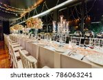 setup wedding table | Shutterstock . vector #786063241