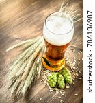glass of natural beer. on a... | Shutterstock . vector #786136987