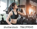 sports young woman girl drinks...   Shutterstock . vector #786199045