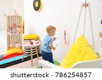 little boy painting on wall at... | Shutterstock . vector #786254857
