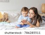 beautiful young woman playing... | Shutterstock . vector #786285511