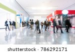 Small photo of blurred people at a trade fair hall
