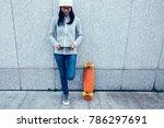 female skateboarder using... | Shutterstock . vector #786297691