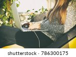 the young woman is sitting on... | Shutterstock . vector #786300175