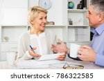 Small photo of Man and woman are lead discussion about agreement of the credit.