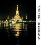Wat Arun temple across Chao Phraya River in the night - stock photo