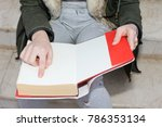 a girl with a book in her hand | Shutterstock . vector #786353134