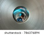 Small photo of Jharkhand India,May,11,2011: Galvanized steel coils batch is meticulously checked by supervisor wearing blue helmet for quality control in steel plant,Jharkhand India,Asia.