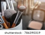 makeup brushes on blurred... | Shutterstock . vector #786390319
