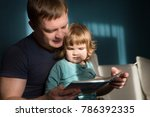 father reading a story to his...   Shutterstock . vector #786392335