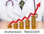 red arrow over stack of money... | Shutterstock . vector #786422335