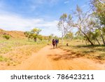 Small photo of People hiking on a hot day along a track in the Pilbara region in North Western Australia, Australia.