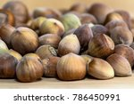 hazelnut kernels on brown table ... | Shutterstock . vector #786450991