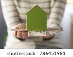 mortgage concept by money house ... | Shutterstock . vector #786451981