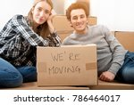 happy young couple moving to... | Shutterstock . vector #786464017