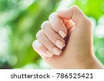 broken nail on a woman's hand... | Shutterstock . vector #786525421