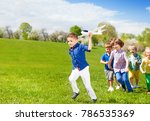 kids running together and boy... | Shutterstock . vector #786535369