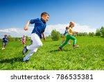 happy running kids in the green ... | Shutterstock . vector #786535381
