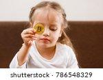golden bitcoin in a child hand...   Shutterstock . vector #786548329