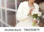 wedding bouquet of white tulips ...   Shutterstock . vector #786550879