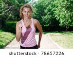 woman running in the park. | Shutterstock . vector #78657226