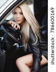 sexy young blonde woman in car. ... | Shutterstock . vector #786600169