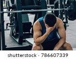 tired man taking a workout rest.... | Shutterstock . vector #786607339