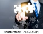 businessman connecting puzzle... | Shutterstock . vector #786616084