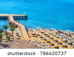 the rows of straw sunshades on... | Shutterstock . vector #786620737