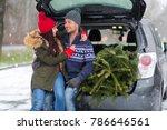 couple loading freshly cut down ... | Shutterstock . vector #786646561