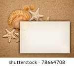 Summer background - shells on sand and blank card - stock photo