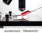 pipette  dropper placing a red... | Shutterstock . vector #786664429