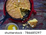 Stock photo yellow cornbread in cast iron skillet on rustic wood table top view 786685297