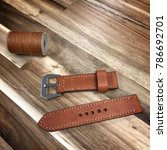 Small photo of Handmade leather watch strap made by pricking iron,stitching thread,burnish and slicker with the wooden.