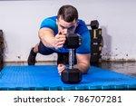 fit  muscular young man doing... | Shutterstock . vector #786707281