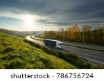 white truck driving on the... | Shutterstock . vector #786756724