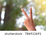 the boy's hand is a two inch...   Shutterstock . vector #786912691