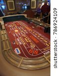 Small photo of CARIBBEAN SEA - DEC 20, 2017 - Craps table of the casino in a cruise ship in the Caribbean Sea