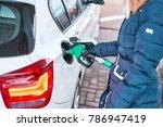 girl in jacket fills petrol... | Shutterstock . vector #786947419
