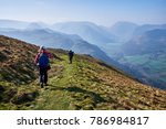 two girls hike high up on place ... | Shutterstock . vector #786984817