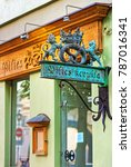 Small photo of Vilnius, Lithuania - September 3, 2015: Brozne plate at the bakery in the old town of Vilnius, in Lithuania
