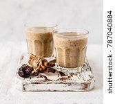 two glasses of date milkshake... | Shutterstock . vector #787040884