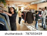 customers and staff in a busy... | Shutterstock . vector #787053439