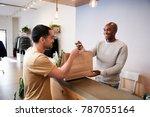 man serving customer at the... | Shutterstock . vector #787055164