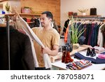 young hispanic man looking at... | Shutterstock . vector #787058071
