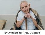 senior man wearing plaid leans...   Shutterstock . vector #787065895