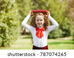 smart little girl  with book in ... | Shutterstock . vector #787074265