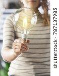 closeup hand holding light bulb.... | Shutterstock . vector #787137985