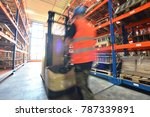 workers in the warehouse of a... | Shutterstock . vector #787339891